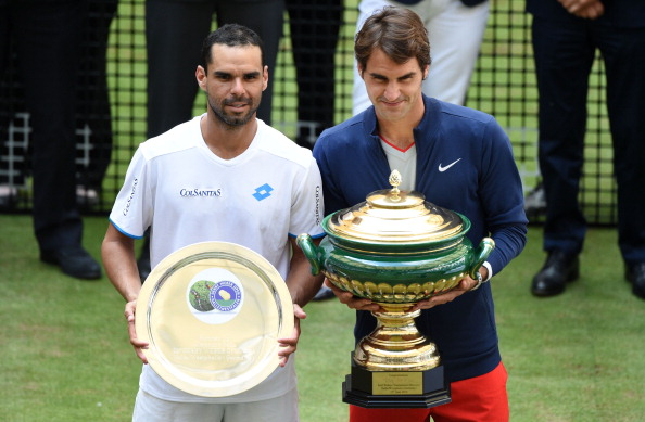 HALLE, GERMANY - JUNE 15: Alejandro Falla of Colombia (L) and Roger Federer of Switzerland pose after the final match against  of the Gerry Weber Open at Gerry Weber Stadium on June 15, 2014 in Halle, Germany.  (Photo by Thomas Starke/Bongarts/Getty Images)