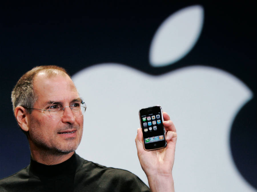 Steve Jobs holding the firs iPhone. Credit image: www.wired.com