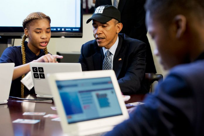 President Obama learns to write code alongside student Adrianna Michell in Newark, NJ.