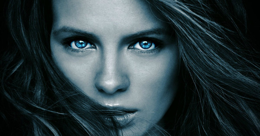 Kate Beckinsale's close-up portrait with the characteristic blue eyes of Underworld's vampires. Image Source: Movie Web