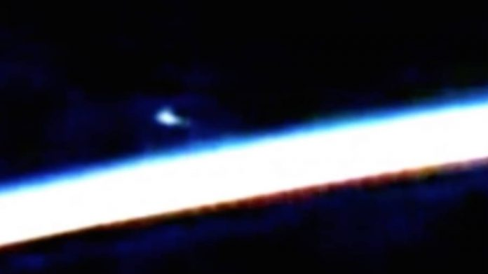 ISS captures UFO hovering Earth.
