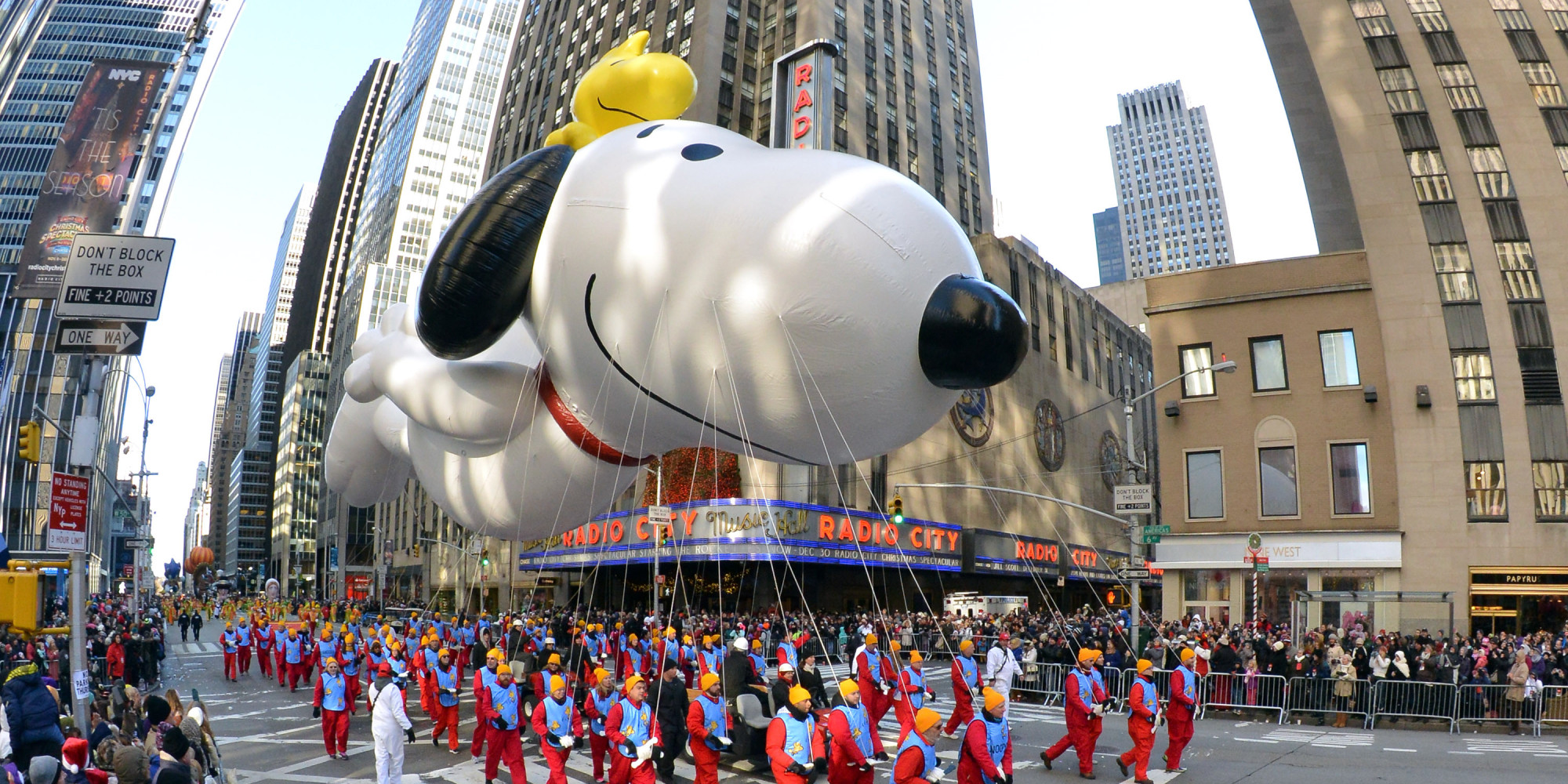NEW YORK, NY - NOVEMBER 28:  (EDITOR'S NOTE: Image was shot with a fisheye lens) Snoopy makes his way down Avenue of the Americas during the 87th Macy's Thanksgiving Day Parade on November 28, 2013 in New York City.  (Photo by Neilson Barnard/Getty Images)