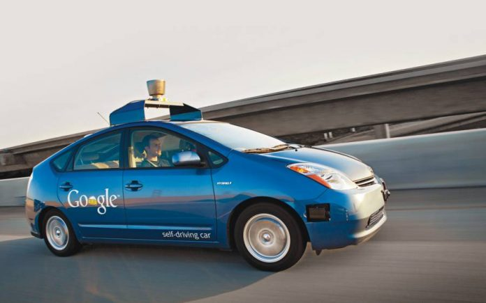 Blue Google autonomous car on the highway
