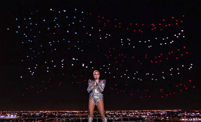 Intel drones form the United States flag behind Lady Gaga at the Super Bowl half-time show.