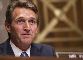 Senator Jeff Flake files a resolution on Tuesday to repeal a set of rules approved last October by the FCC