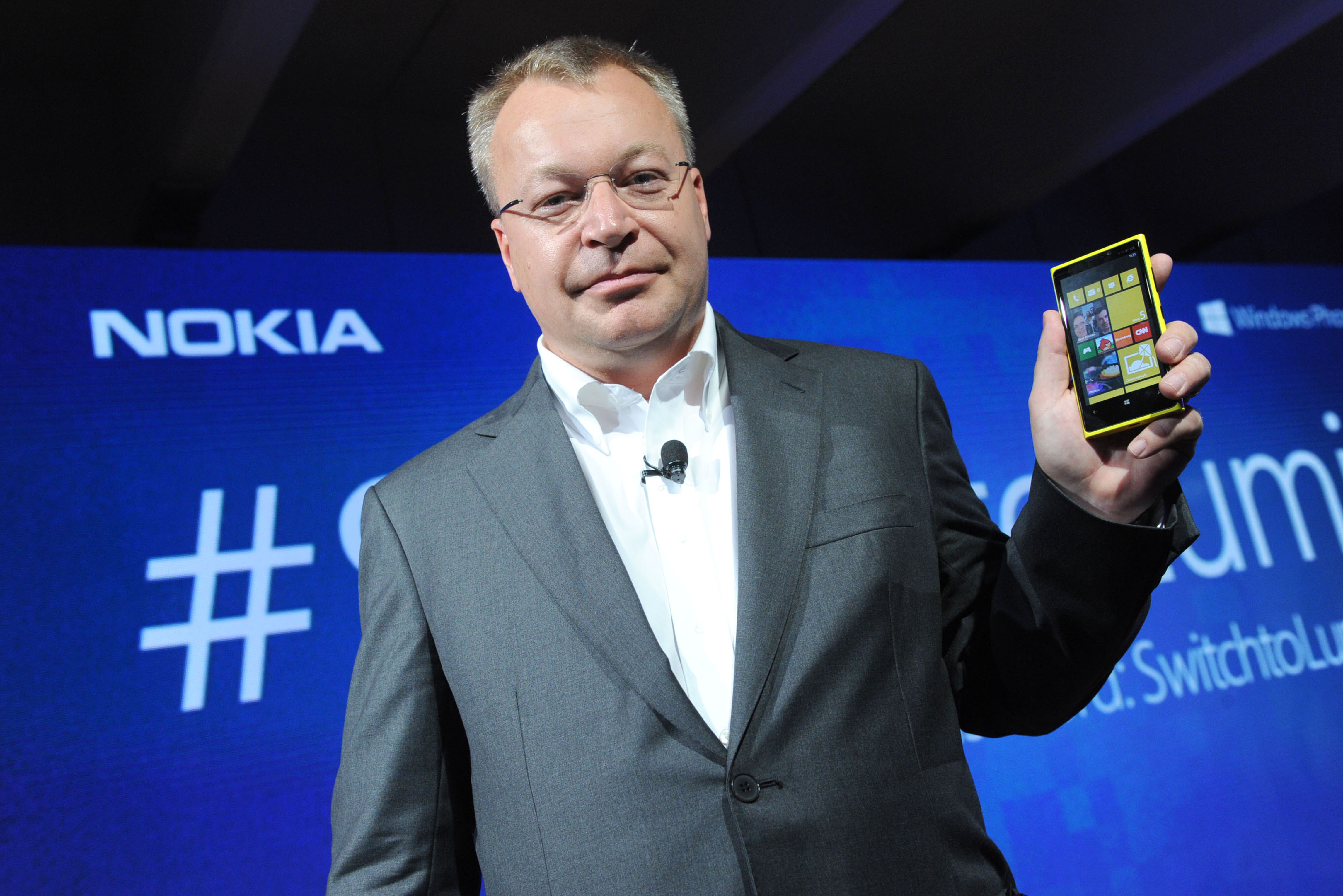 Nokia President and CEO Stephen Elop debuts the Nokia Lumia 920, NokiaÕs flagship Windows Phone 8 smartphone, at a press event in New York, Wednesday, Sept. 5, 2012.   The Lumia 920 features a camera able to take in five times more light than competing smartphones for sharp pictures in low light without flash, and the phone comes with integrated wireless charging as well as an augmented reality mapping app, Nokia City Lens.   (Photo by Diane Bondareff/Invision for Nokia)