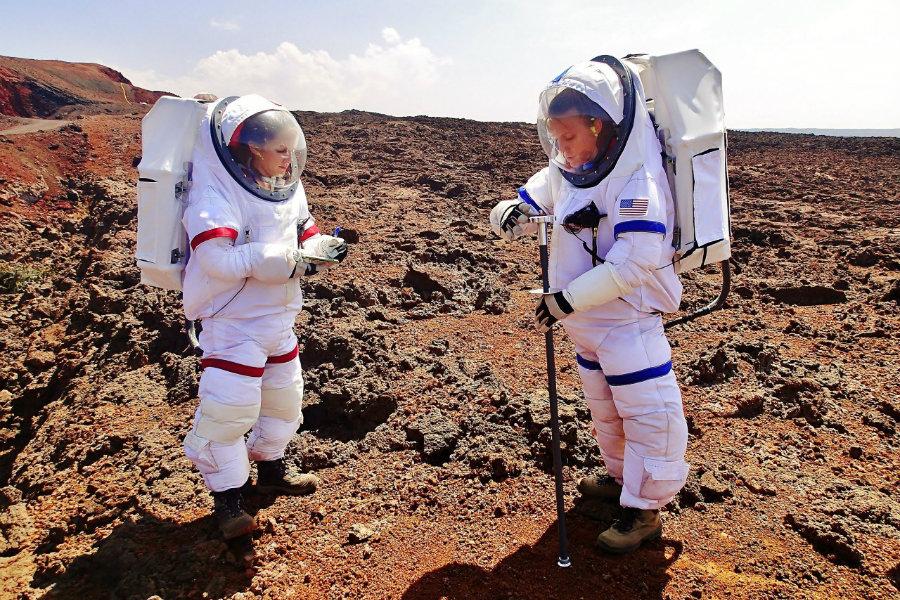 HI-SEAS crew members Anne Caraccio and Tiffany Swarmer conduct a mock-EVA. Image Source: Space