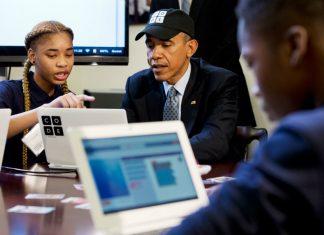 President Obama learns to write code alongside student Adrianna Michell in Newark, NJ.