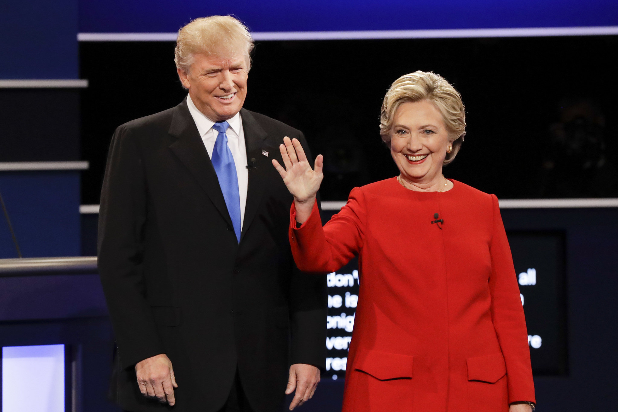 A photo of Democrat presidential candidate Hillary Clinton and Republican presidential candidate Donald Trump arriving on stage for the debate. Image Source: Syracuse