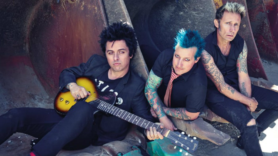An official picture of the current faces of Green Day band members. Image Source: Rolling Stone