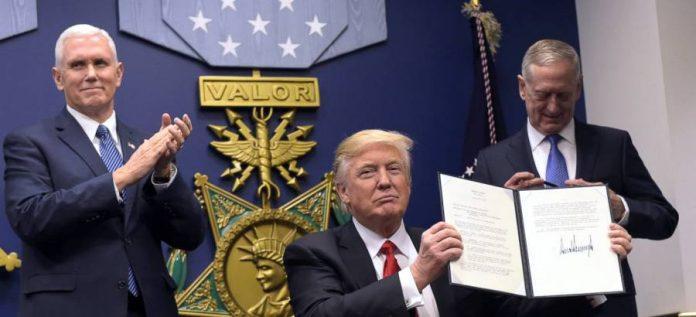 President Trump signs anti-Muslim executve order.
