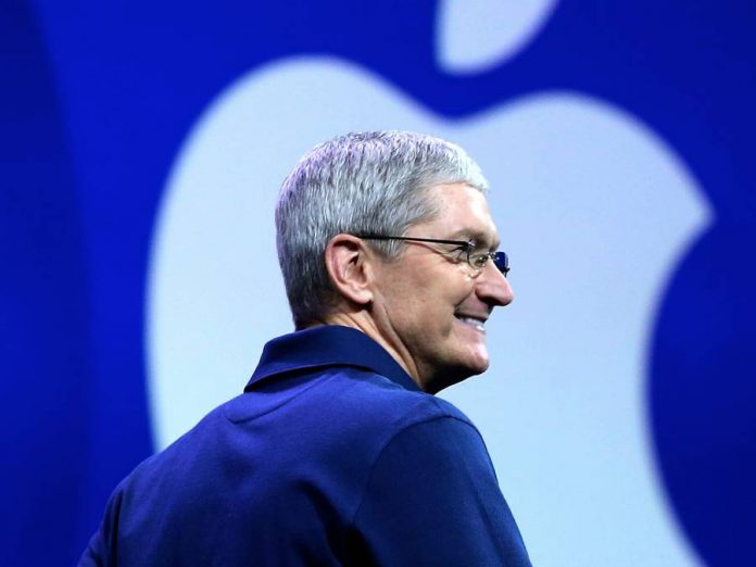 Tim Cook-smiling-Apple logo