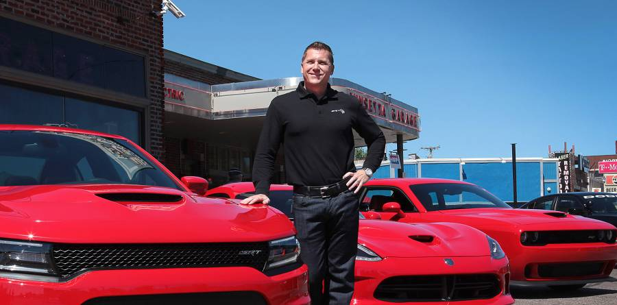 Tim Kuniskis, Dodge's chief, with fleet of Dodge Chargers.