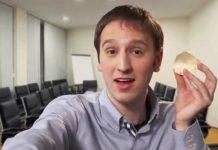 Steve Keating holding a 3D print of his brain tumor.