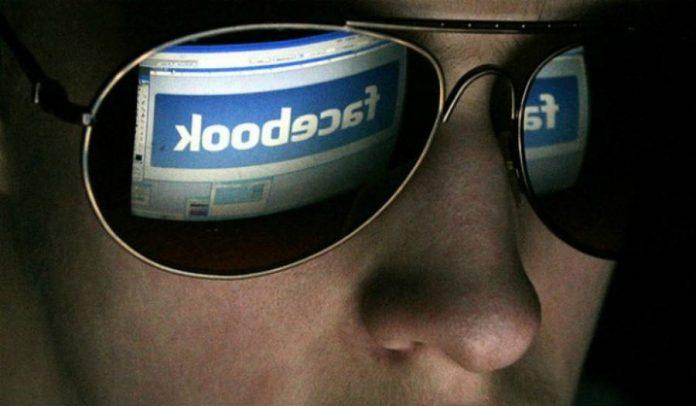 Facebook logo reflected on shades