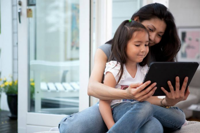 Mother and daughter using a tablet