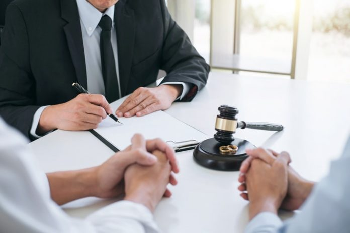 Lawyer Signing Documents
