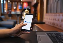 Man Using PayPal on Smartphone