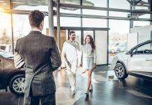 Family Visiting Car Dealer