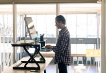 Employee Working on Standing Desk