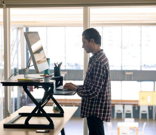 Employee Working on Standing Desk
