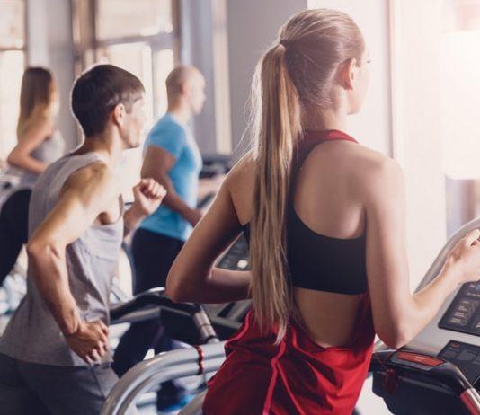 Man & Woman Exercising on Treadmill