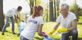 Two Volunteers Picking Up Garbage