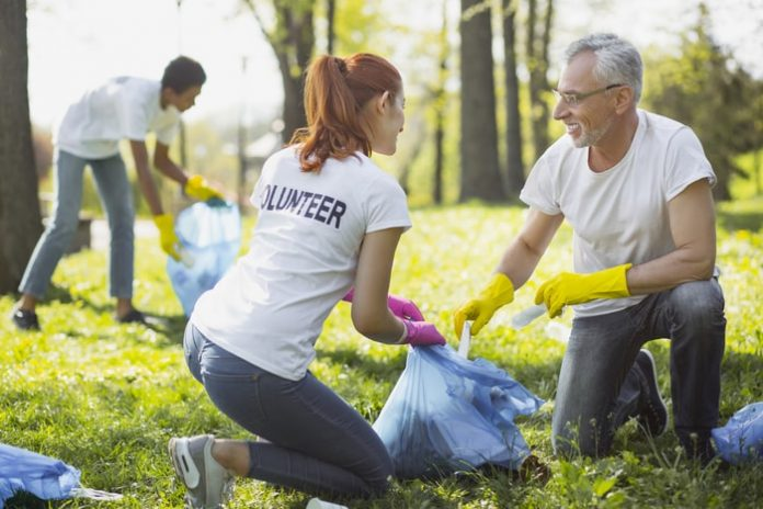 Two Volunteers Picking Up Garbage